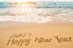 write-happy-new-year-beach-word-76361875